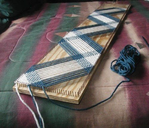 Weaving on the bias. Wood rectangle & nails