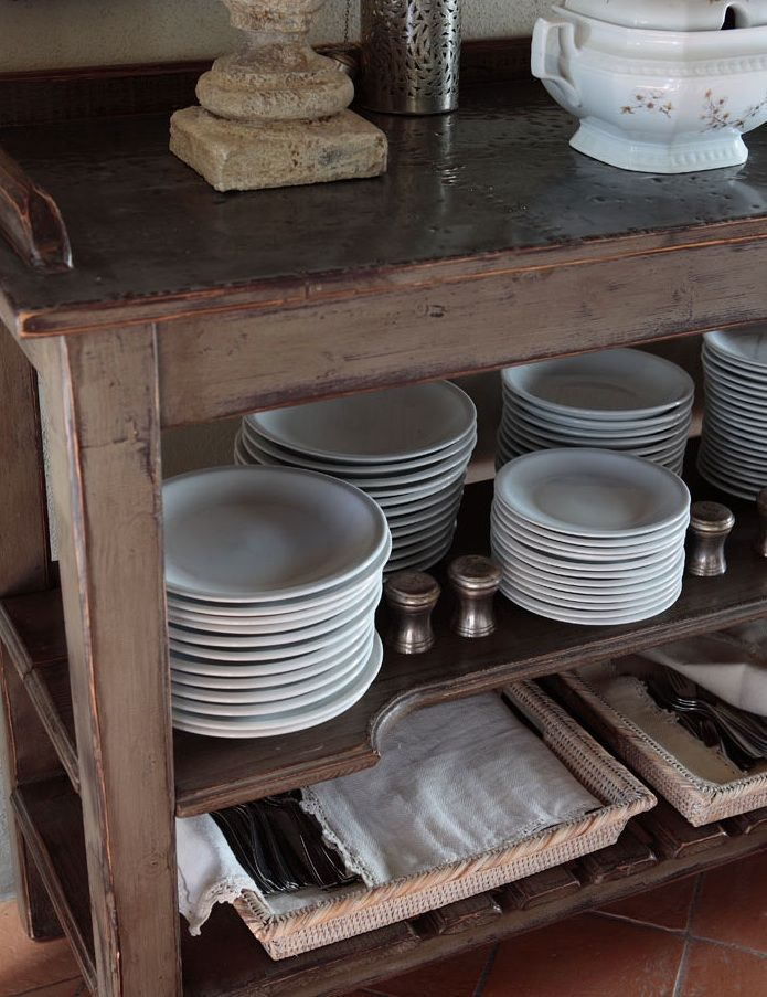 Italian farmhouse. I love white tableware. It looks so vintage & if a piece breaks it can be easily replaced.