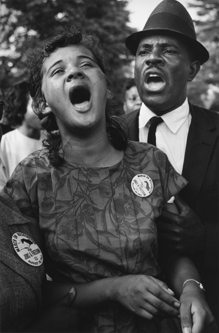 """Washington, D. August Demonstrators sing """"We Shall Overcome"""" after Martin Luther King's """"I Have a Dream"""" speech. By Leonard Freed."""