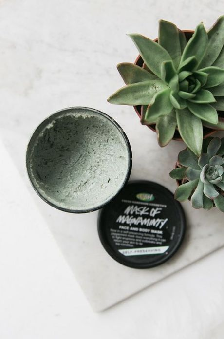 Lush green mask, styled flatlay on white marble with succulents