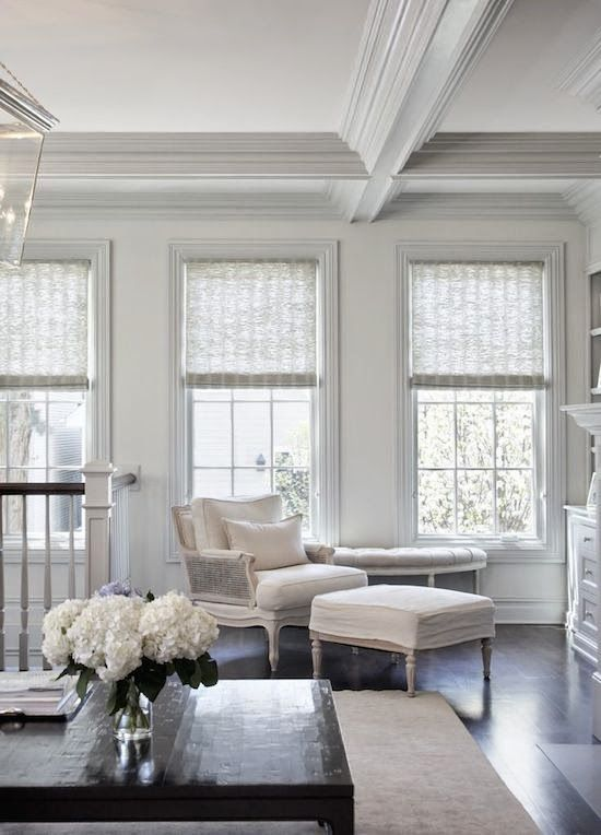 Love this soft neutral room with dark wood coffee table
