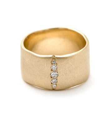 For a bolder look with a touch of glam...this 14KY satin finish gold band has a soft everyday look with an unexpected, sparkling slice of pavé set diamonds.
