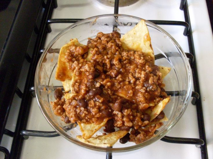 Beef and Bean Nachos from Natalia C. in Naucalpan, Mexico:  1/2 kilo ground beef (can use half beef and half pork) 1 small box of spaghetti sauce 1 can of whole pinto or black beans 1 Bag of chips  Fry the meat with a little salt.  Add sauce and beans; if the mixture is too think, add water. Bring to a boil and stir. Let simmer for five minutes. Serve with tortilla chips!  #HTTR #RedskinsRecipes