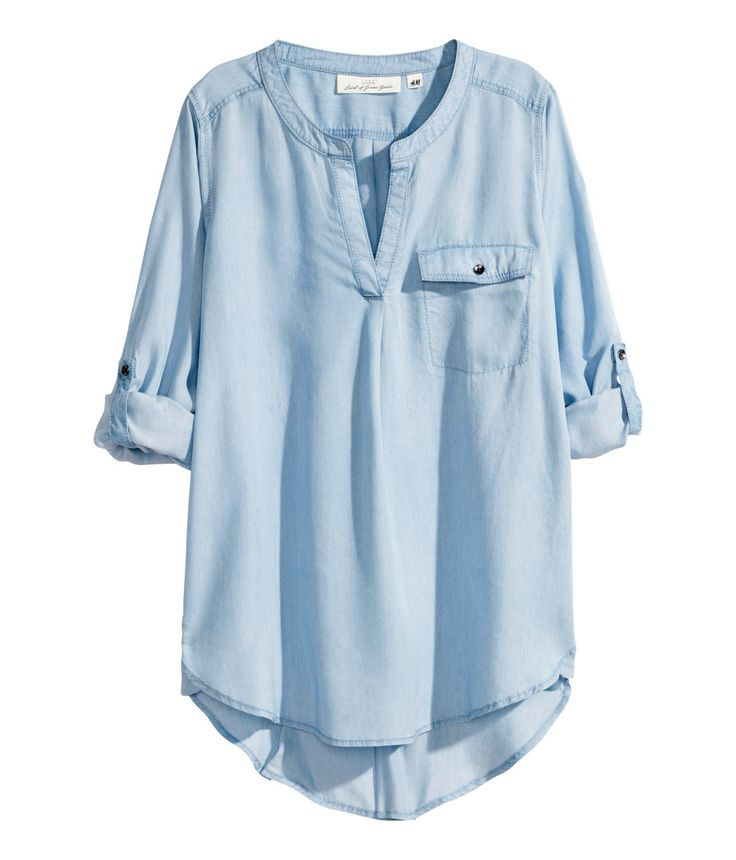 Light blue long-sleeved tunic with chest pocket and roll-up buttoned tab. | H&M Denim