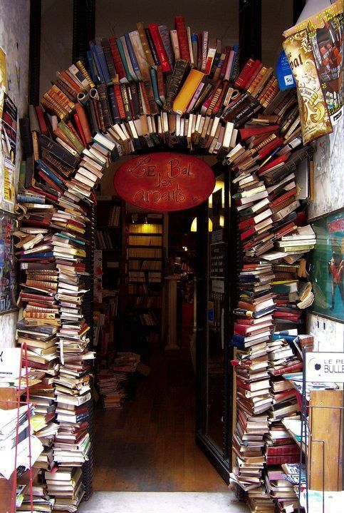 "This book arch is the entrance of a book store ""Le Bal des Ardents"" in Lyon (Rue Neuve), France. (Picture via Breathing Books)"