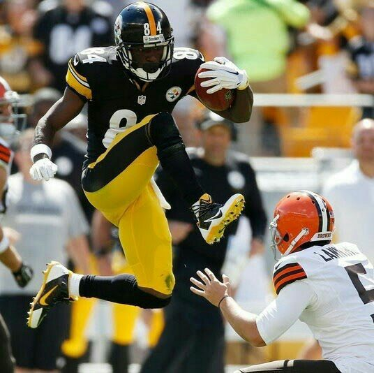 Antonio Brown kicks Brown's punter on a punt return. Best play EVER