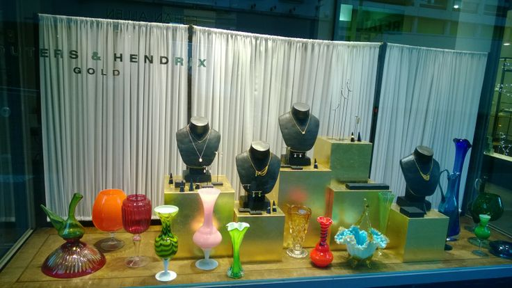 a shop window with vases