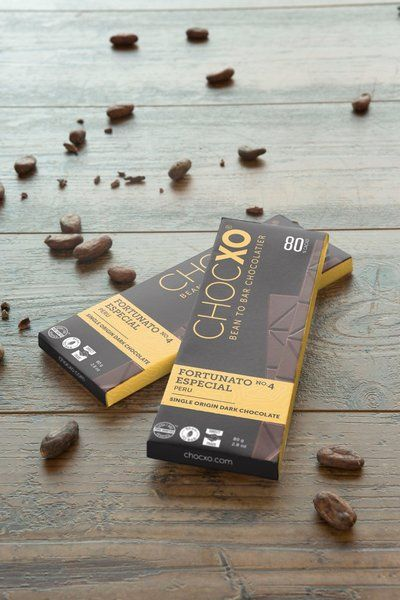 """ChocXO Fortunato 80% Dark  Recently rediscovered by Don Fortunato, a long time Peruvian farmer, """"Pure National Cacao"""" was thought to have been lost over a century ago. The unique quality of Pure National cacao lies in the fact that the trees grow in natural conditions and have done so for centuries, allowing them to yield a small amount of rare white cacao beans that lend a nutty flavor to the abundant fruity and floral notes."""