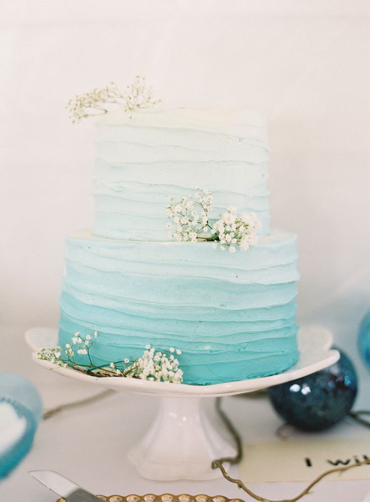 A pale blue ombre wedding cake would be lovely as the centrepiece of a non-beachy sea glass wedding.