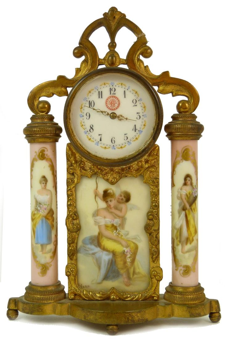 Antique Bronze Clock with columns. Clock depicts cherub with beautiful woman. Clock is signed Prodige.