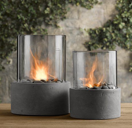 Whoa, a mini fire pit! Imagine three of these as centerpieces down a long outdoor dining table... very cool.
