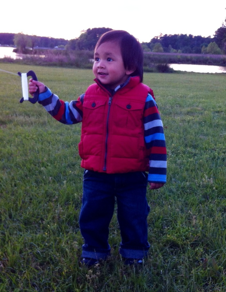 The expression on his face says it all...he LOVED flying his first kite!