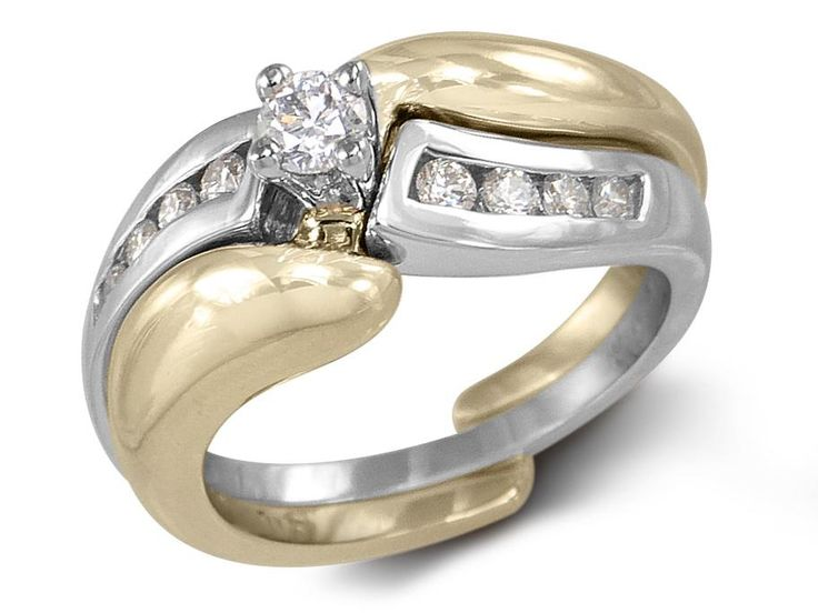 Yellow gold tiffany band solitaire8 channel-set diamond bandCenter diamond weight: .15ct Band diamond weight: .21ctTotal diamond weight: .36ct Gold: 14 carats