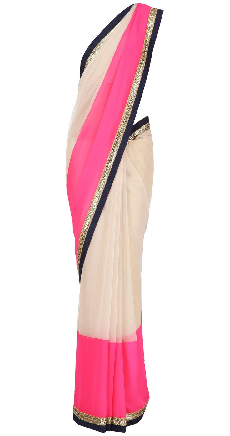 Nude net Sari with neon pink chiffon and navy blue raw silk and gold embroidered border. It comes with a navy blue raw silk blouse piece.