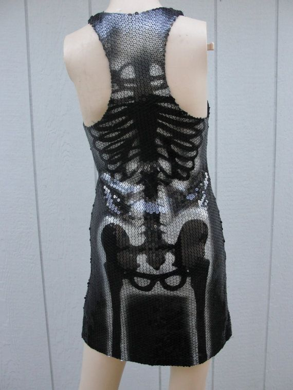Upcycled sequin mini dress hand painted with skeletons labeled as a size small.  Measurements taken across front lying flat -stretchy!  16 across front armpit to armpit 14 across waist 17across hips 33 length stretch material