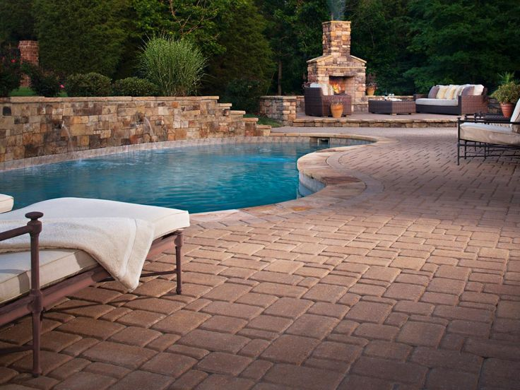 dreamy pool design ideas outdoor projects hgtv remodels love the fireplace in the pool area