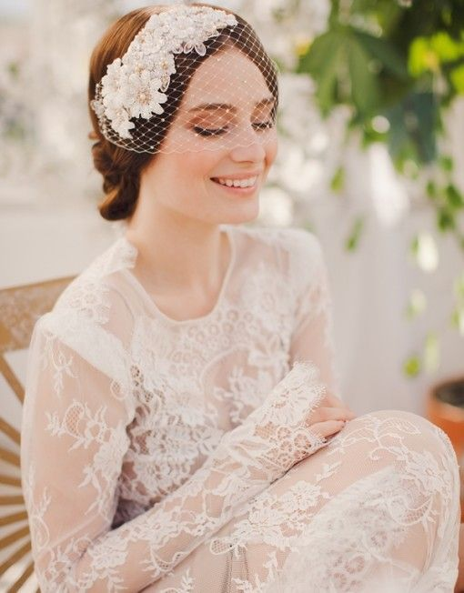 Birdcage veil adorned with flower from Jannie Baltzer http://janniebaltzer.com/product/maya-2/