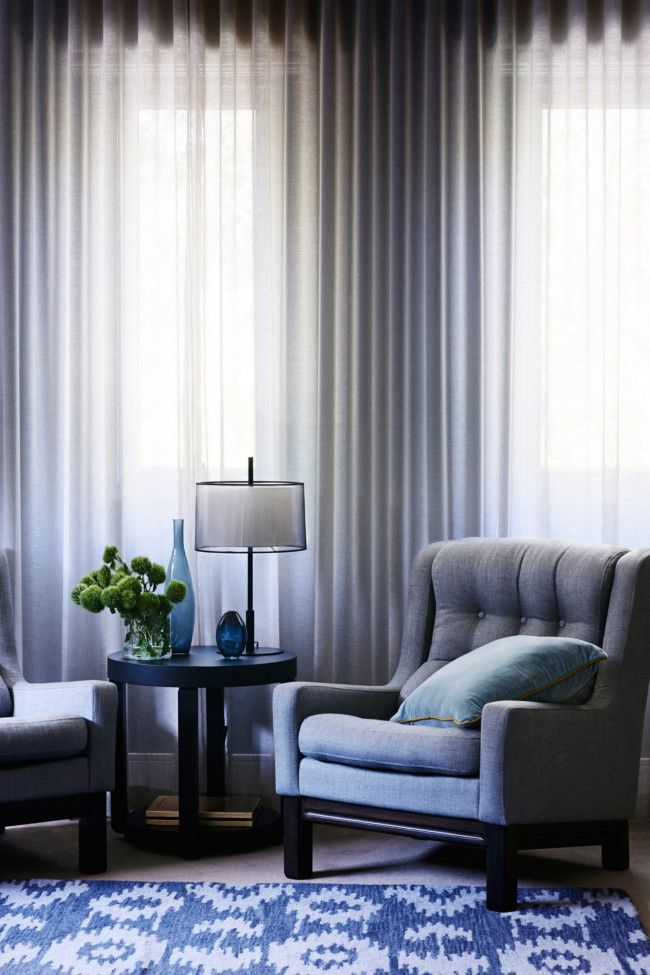 Love the grey sheer curtains, grey chair and grey/ blue floor