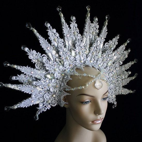 As regal and icy as Queen Jadis herself. This snowflake shaped headdress is created from Silver lace, decorated with swarovski AB, opal and diamond