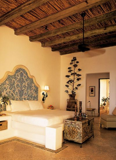 nice spanish style bedroom...warm & sexy :) www.PasticheWellness.com