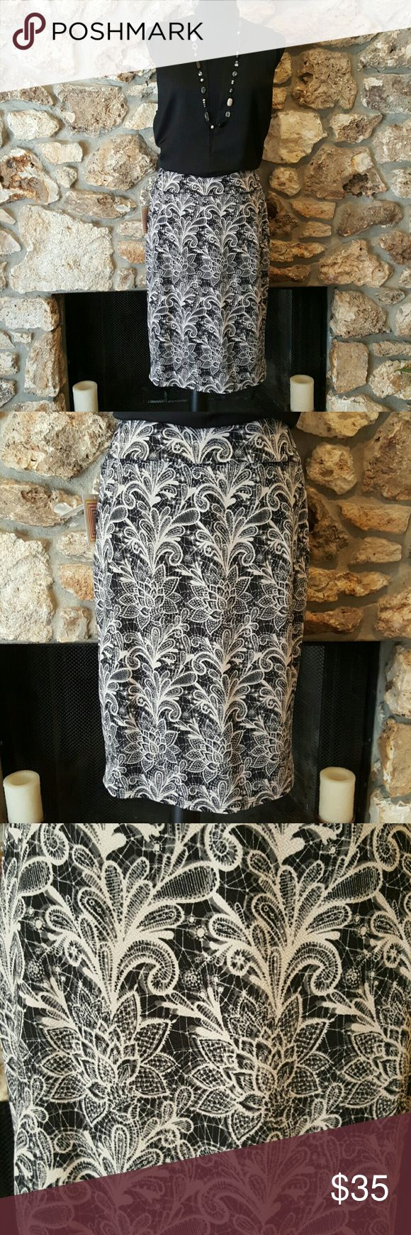 Large Lularoe Cassie Skirt - NWT Large Lularoe Cassie Skirt.  Gorgeous black with cream lotus flower print. Never worn, new with tags. Price is firm unless bundled. LuLaRoe Skirts Pencil