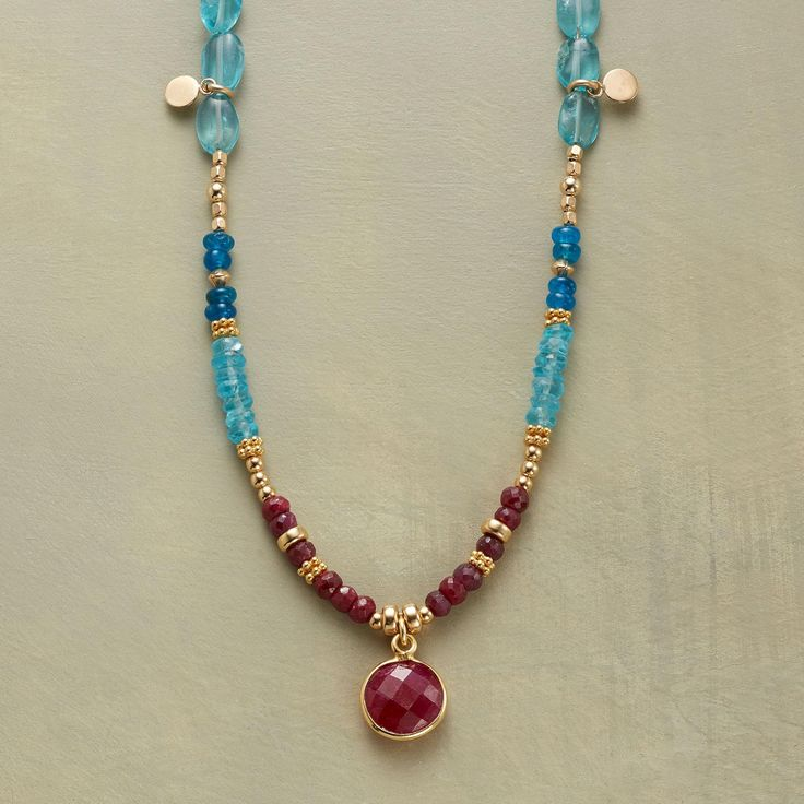 """RUBY BLUES NECKLACE--Ruby rounds in golden rims are spotlights amid a two-blue mix of apatites, smooth and faceted. Paillettes and a variety of 14kt goldfill beads lend their glow. Toggle clasp. Sundance exclusive handcrafted in USA. 17""""L."""