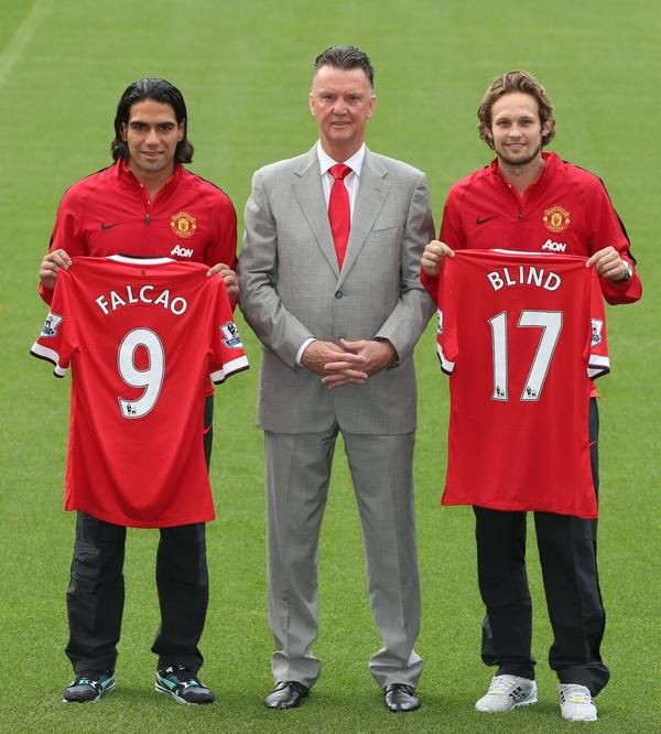 Louis van Gaal looks proud as punch next to Radamel Falcao and Daley Blind.