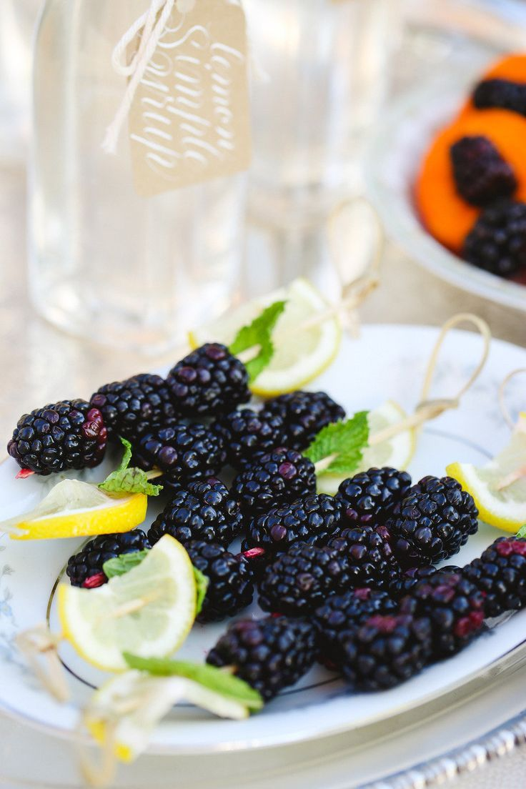 blackberry drink stirs http://itgirlweddings.com/nyc-rooftop-engagement-party/