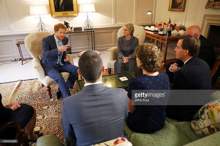 Prince Harry and The Duchess of Gloucester in her capacity as Papworth Hospital's Royal Patron, talk after presenting Staff Sergeant Elizabeth Marks' gold medal to members of the medical team from Britain's Papworth Hospital at Kensington Palace on June 1, 2016 in London, England. At the 2016 Invictus Games in Orlando, U.S. SSgt Elizabeth Marks asked Prince Harry to present her 100m swimming freestyle medal to the team at Papworth Hospital, who she credits for saving her life.