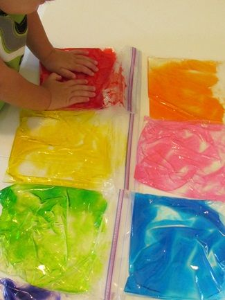 hair gel + food coloring = great OT/sensory play (add in color and letter/sound recognition and spelling for older kids who still need the OT) Used this for my preschool class...they loved it.just make sure you tape them shut or they will pop them :)