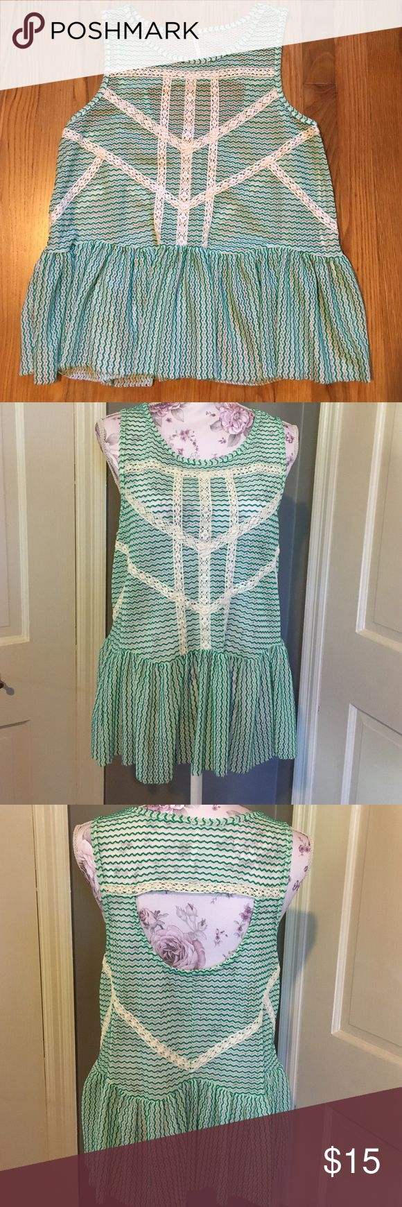 Free People lacy green and cream cami top Free People lacy green and cream cami tank top. Size medium. Polyester and nylon. Free People Tops Tank Tops