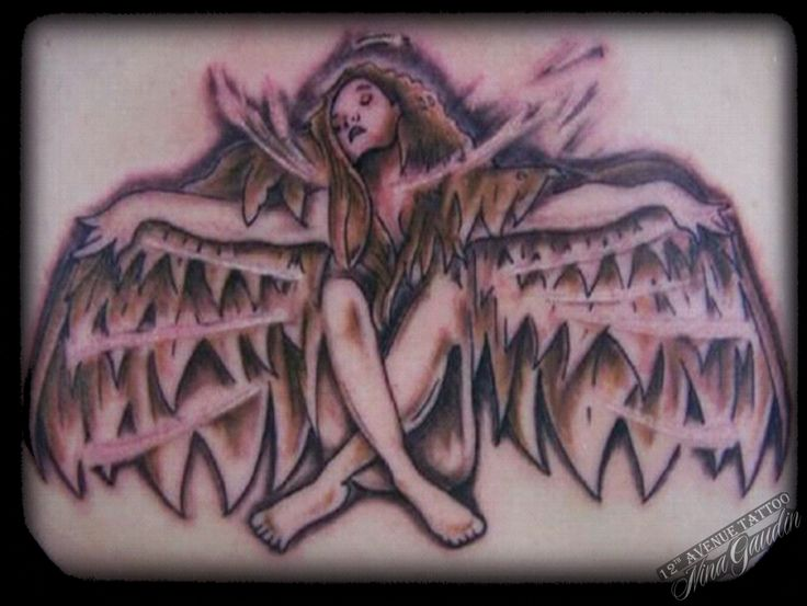 Angel with wings and outstretched arms color low back - Tattoo by Nina Gaudin of 12th Avenue Tattoo in Nampa, ID