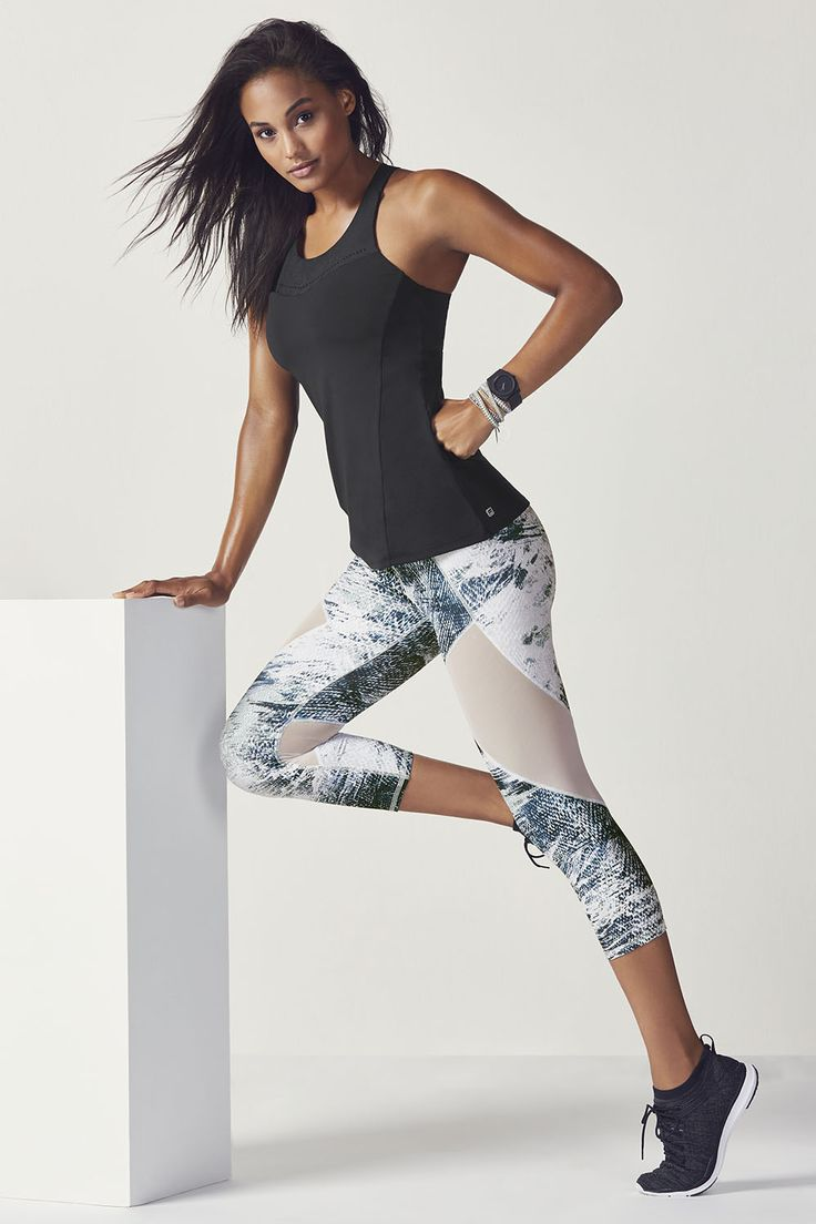 Gabi @ Fabletics / Say bye to bounce with our built-in bra performance tank and compression capris, designed with breathable mesh inserts.