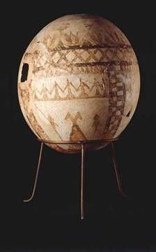 Etruscan? (probably imported from the orient), mid 7th century BC. Ostrich egg decorated with geometric shapes and rows of birds, lotus buds and dancing figures. Ostrich egg, ochre coloured painting, height 16.9 cm, diameter 12.1 cm. Confiscated in Montalto di Castro (1961) Inv. No. 3987