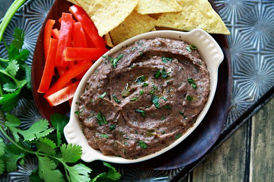 Black Bean Hummus - 1 – 15 ounce can black beans, drained and rinsed  1 clove garlic  2 1/2 tablespoons olive oil  2 tablespoons Tahini  juice of 1/2 a lime  1/2 teaspoon cumin  1 teaspoon chili powder  1 – 2 tablespoons (packed) chopped fresh cilantro  1 – 2 tablespoons fire roasted diced green chiles, optional  salt and pepper, to taste