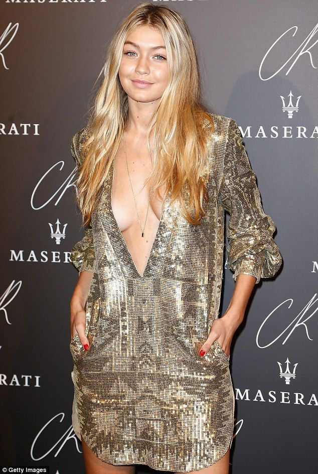 Gigi Hadid left little to the imagination in a very low-cut silver and gold sequined dress at the CR Fashion Book party in Paris http://dailym.ai/1rV55IL #PFW