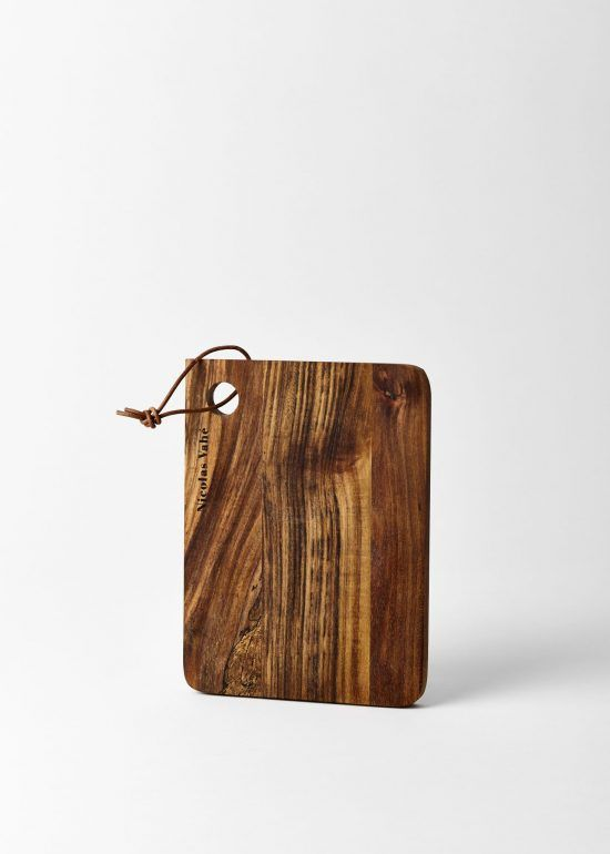 A tasteful Nicholas Vahe small wooden chopping board, which makes a great platter for serving cheeses or a tasty sharing mezze.