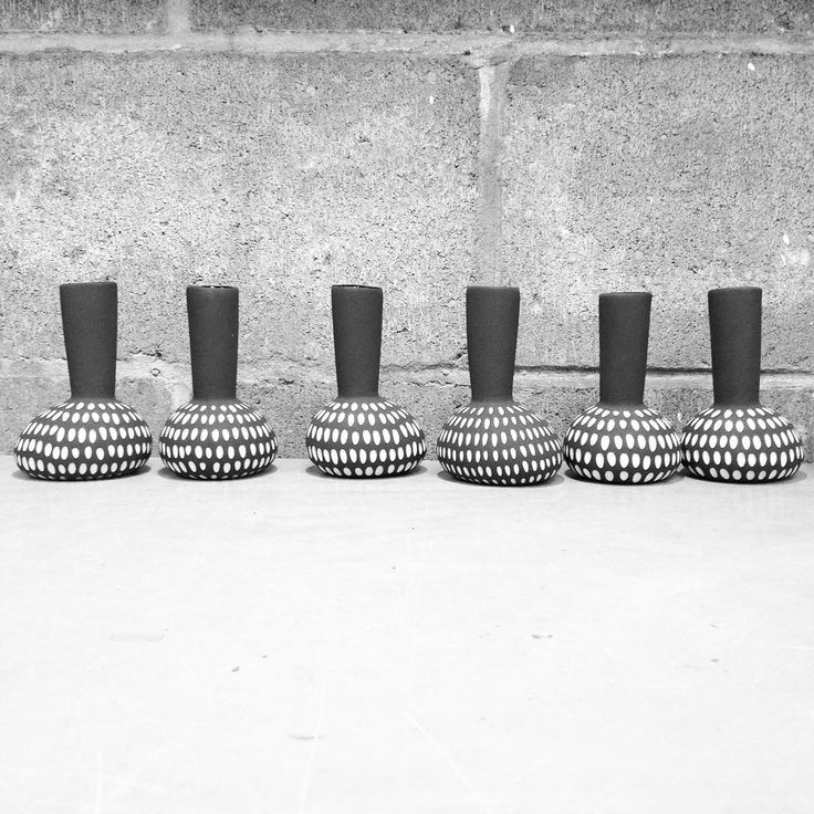 Black and white line up. There is also a thunder storm happening right now...adds to the atmosphere. #pottery #ceramics #blackandwhite