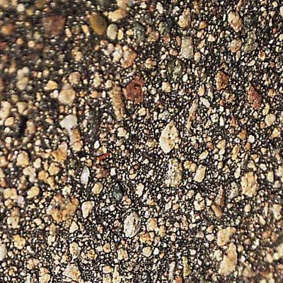 Chip seal driveway.  Gravel rolled into asphalt emulsion.