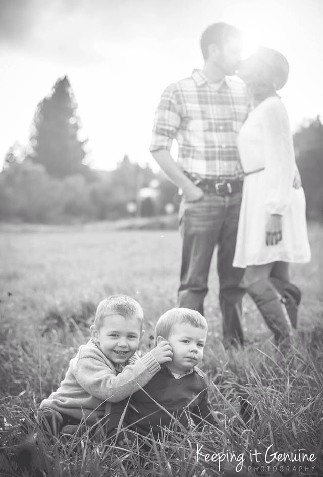 Rustic family photo in the field. Love these boys.