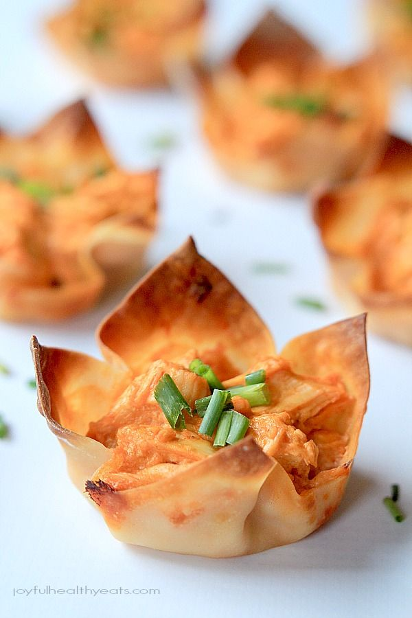 A lighter, healthier twist on a classic appetizer recipe; Skinny Buffalo Chicken Wonton Cups done in 30 minutes! | www.joyfulhealthyeats.com #superbowl