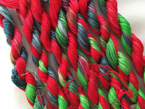 This is my hand dyed thread in the colourway Elf Toes on 9m DMC six stranded floss for cross stitch or embroidery, or other needlework. A festive