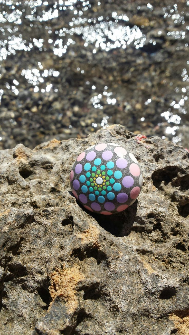 Handpainted stone dots mandala