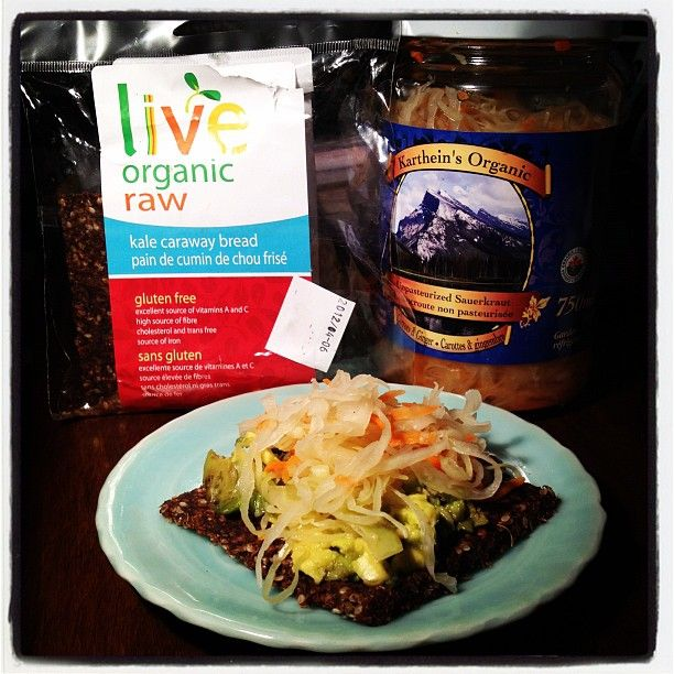 Lunch Time: Live's Organic Raw Kale Caraway Bread topped with Avocado and Karthein's Sauerkraut!