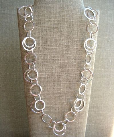 Hand forged medium weight interlocking circles link necklace priced for 18''. This style is available in Sterling Silver,14kt Gold Filled and Mixed Metals. Other lengths available, adding $8.00 to the
