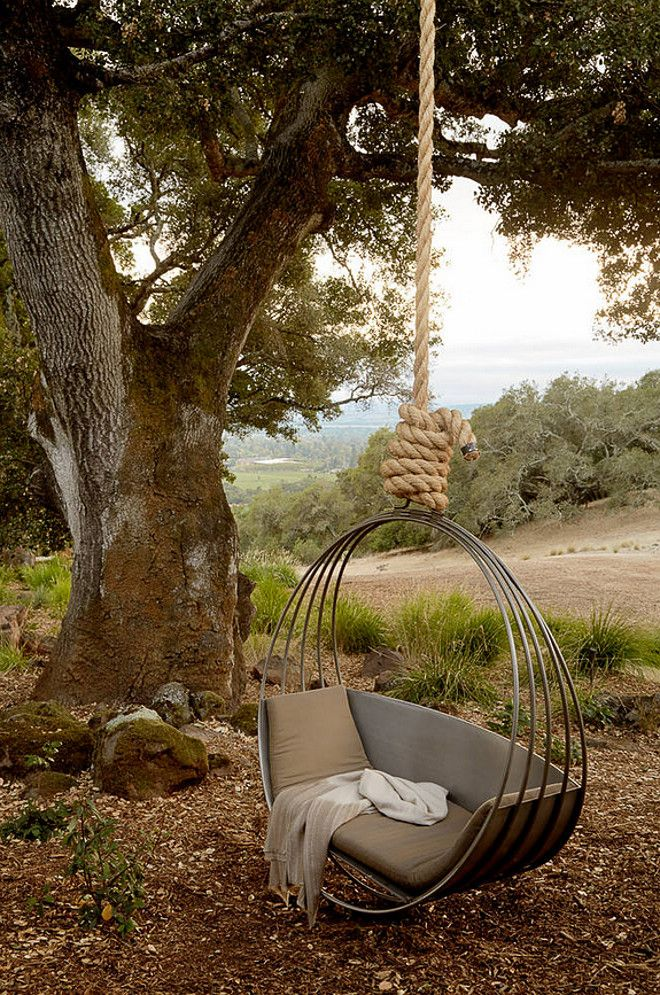 Tree swing. Modern tree sing. Hanging chair on tree. Hanging chair is custom built by Erin Martin Design, St Helena. Ken Linsteadt Architects