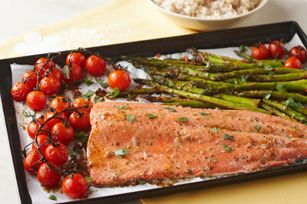 One-Pan Roasted Salmon Supper recipe - Each serving of fish, vegetables and rice for this recipe comes in at fewer than 400 calories!