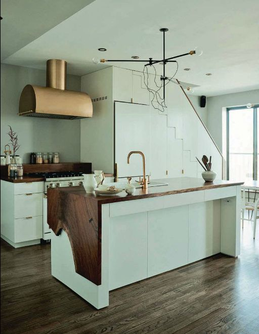 Still one of my favs. I mean, a brass hood and faucet, perfectly hidden fridge and pantry under the stairs and that to die for live edge waterfall coutertop...what's not to love?!