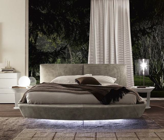 Zero Designer Round Bed combines volume and structurally defined forms into a harmonious visual effect that stands to amplify its relentless totality in the most aesthetically successful manner. Manufactured in Italy by Presotto, Zero Round Bed stands apart by using standard queen size mattress instead of a round one making it not only a stunning bedroom solution but a practical one as well. Uses a standard queen size mattress. Allow 3-4 months for delivery.
