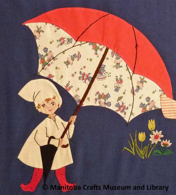 """Detail:  A children's design appliqued on dark blue cloth;  made by the embroiderers' group of the CGM for an open house called """"World of the Children""""."""